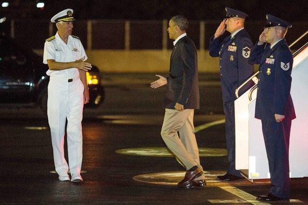 President Obama arrives at the Joint Base Pearl Harbor-Hickam in Honolulu early Wednesday.