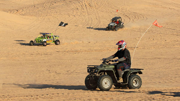 Off-highway vehicle enthusiasts race at Buttercup sand dunes west of Yuma on New Year's Eve.