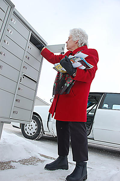 Lena Schornack has osteoporosis and relies on a neighbor to retrieve her mail from the neighborhood mailbox during the winter.