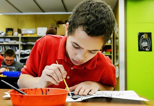 Sixth-grader Jalen Moudy paints with watercolors during his art class at Fairview Elementary School in Waynesboro, Pa., on Wednesday. Students were back in school after the holiday break.