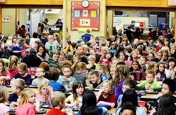 Students crowd into the cafeteria for lunch at Fairview Elementary School in Waynesboro, Pa., on Wednesday as classes resumed after the holiday break.