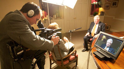 The Reagan Presidency producer Robert Huck (from left) records an interview which fellow producer Tracy Dorsey is conducting with former U.S. Attorney General Ed Meese.