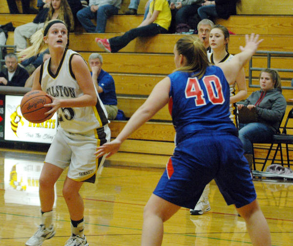 Pellston senior center Emma Dunham (left) looks inside as Central Lake sophomore forward Allie Hines defends during Wednesdays Ski Valley Conference contest at the Pellston High School gym. The Trojans defeated the Hornets, 43-29, as Pellston falls to 1-3 on the season.