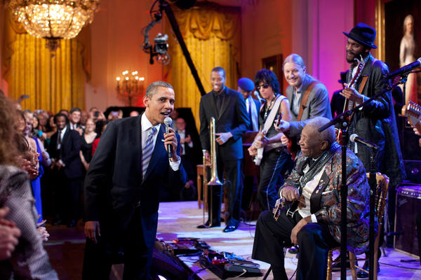"""Egged on by B.B. King, at right, the President joins in singing 'Sweet Home Chicago' during the 'In Performance at the White House: Red, White and Blues' concert in the East Room. Participants include, from left: Troy 'Trombone Shorty' Andrews, Jeff Beck, Derek Trucks, B.B. King, and Gary Clark, Jr,"" White House photographer Pete Souza said."