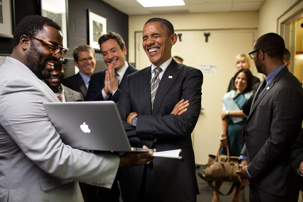 "April 24, 2012 ""We were backstage at the University of North Carolina in Chapel Hill for the President's appearance on 'Late Night with Jimmy Fallon.' The President let out a big laugh as he was being briefed by the producers and Mr. Fallon on the 'Slow Jam the News' segment,"" White House photographer Pete Souza said."
