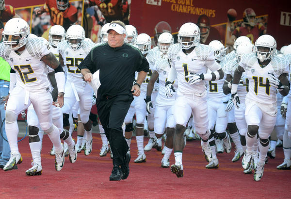 Oregon Ducks coach Chip Kelly and players run onto the field before the game against the USC Trojans. Many suspect this will be Kelly's final game as head coach of the Ducks as he has received great interest from numerous NFL teams.