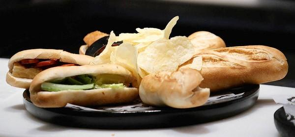 Platters of tapas-size sandwiches at 100 Montaditos are served with crisp potato chips.