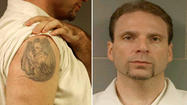 The FBI has released a detailed photograph of a distinctive devil tattoo on the right shoulder of escaped bank robber Kenneth Conley, but has no new leads on his whereabouts since his escape with his cellmate from the Metropolitan Correctional Center two weeks ago.