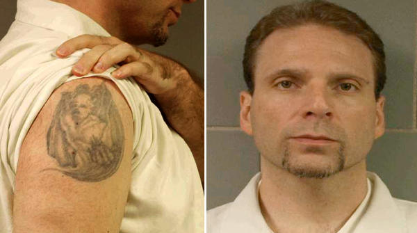 Kenneth Conley, 38, escaped from the Metropolitan Correctional Center in downtown Chicago early Tuesday, Dec. 18, 2012. The FBI has released a picture of Conley's tattoo to aid in their search for him.