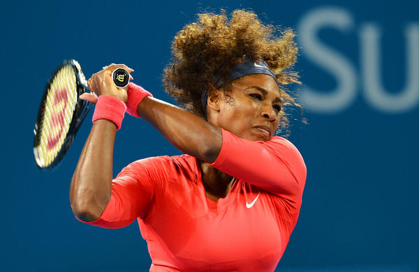 Serena Williams of the US hits a backhand return to Alize Cornet of France in their second round women's singles match at the Brisbane International tennis tournament on January 1, 2013.