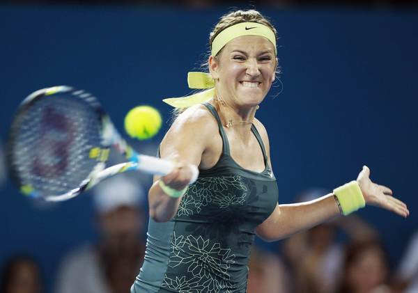 Victoria Azarenka of Belarus hits a return to Sabine Lisicki of Germany during their women's singles match at the Brisbane International tennis tournament January 2, 2013.
