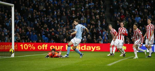 Manchester city's Edin Dzeko (2nd L) shoots to score against Stoke City during their English Premier League soccer match at The Etihad stadium in Manchester, northern England, January 1, 2013.