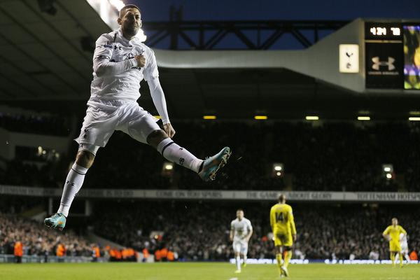 Tottenham Hotspur's Clint Dempsey celebrates after scoring against Reading during their English Premier League soccer match at White Hart Lane in London January 1, 2013.