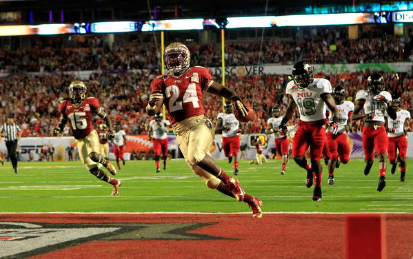 Lonnie Pryor #24 of the Florida State Seminoles scores a 60-yard rushing touchdown in the first quarter against the Northern Illinois Huskies during the Discover Orange Bowl at Sun Life Stadium on January 1, 2013 in Miami Gardens, Florida.