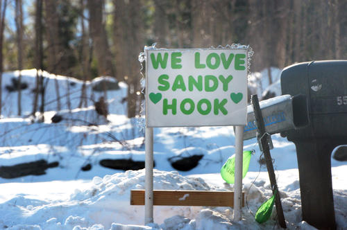 Students and faculty of Sandy Hook Elementary School in Newtown, went back to school Thursday, for the first time after the mass killings on December 14. Monroe has allowed Newtown to use Chalk Hill Middle School and rename it Sandy Hook Elementary School. Faculty and volunteers redecorated it to look as much like their old school as possible. Neighbors to the school and towns people put signs out to welcome the children back to school.