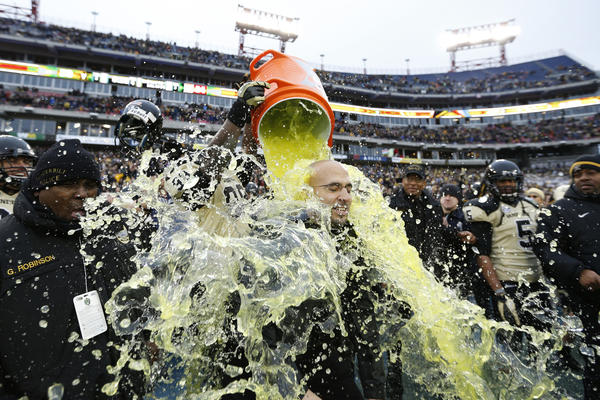 Head coach James Franklin of the Vanderbilt Commodores gets showered with Gatorade at the end of the game against the North Carolina State Wolfpack during the Franklin American Mortgage Music City Bowl at LP Field on December 31, 2012 in Nashville, Tennessee. Vanderbilt won 38-24.