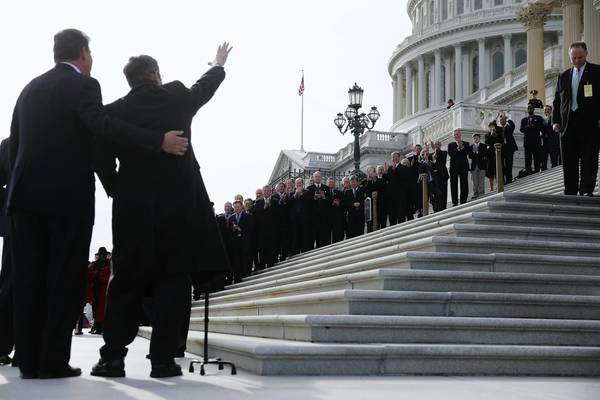 U.S. Sen. Mark Kirk (R-Ill.) greets a group of well-wishers as he walks up the steps of the Capital in Washington, D.C. Sen. Kirk is returning to the Senate after suffering a stroke nearly a year ago.