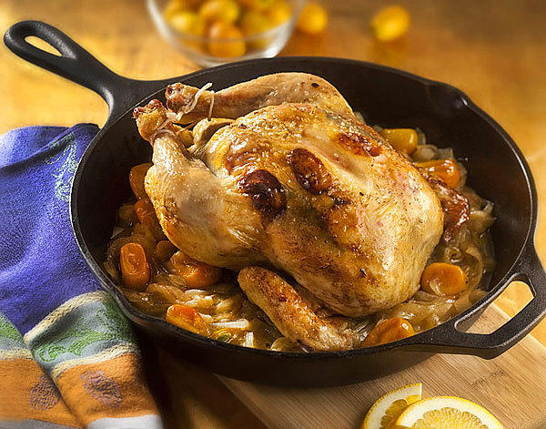 Kumquats, the oblong citrus many of us admire but blithely pass on by at the grocer, do a yeoman's job in this roasted chicken dish, contributing big flavor beyond expectations for their diminutive size.