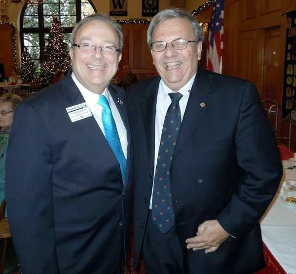Thomas DeJullio, left, president of Kiwanis International, was honored Friday at the University Club in Pasadena. Shown with him is Jim Philips, president of the Kiwanis Club of La Cañada's noon group. The Kiwanians had a float in the 2012 Rose Parade.