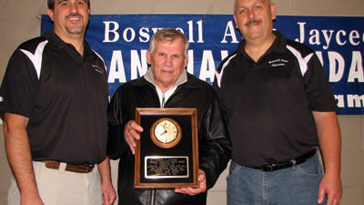 Dave Lepley, Boswell American Legion Post 461 Commander, center, accepts the Joseph H. Hoffman Memorial Community Service Award from Jeff Hoffman, left, Jaycees member and representing the Hoffman family and Mike Novak, right, Jaycees president.
