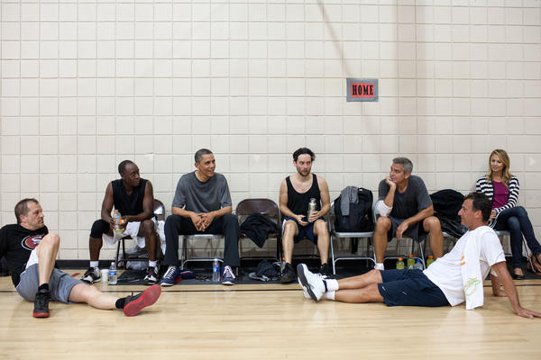 The President talks with Don Cheadle, Tobey Maguire, and George Clooney, two of Clooney's long-time friends and Stacy Kiebler after a basketball game. The photo, taken in May, was released as part of gallery highlighting the year's best work of White House photographer Pete Souza