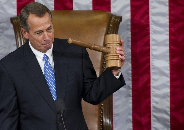 Speaker of the House John Boehner, holds up his gavel after being re-elected as Speaker of the House during the opening session of the 113th House of Representatives.