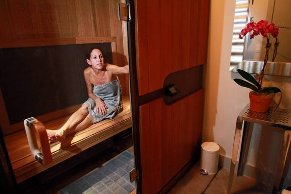 Sherri Musinsky, 51, of Boca Raton, tries out the infrared sauna at Infrasweat in Delray Beach.