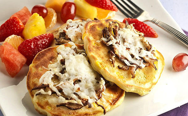 Pancakes for dinner can't help but bring fun to the table, Lisa Schumacher, the Tribune test kitchen recipe tester, reminds us. Here, she gives them a savory twist.