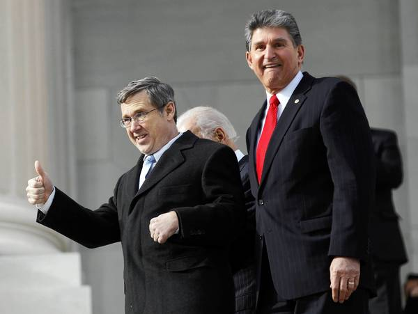 Sen. Mark Kirk, with Sen. Joe Manchin (D-WV) celebrates his climb up steps of the U.S. Capitol as he returns to work, a year after suffering a stroke.
