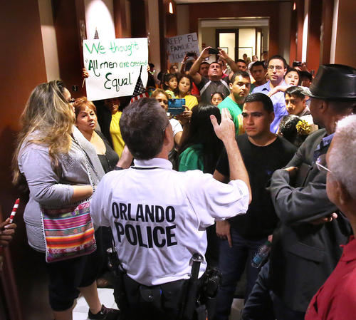 Scenes from the rally and march of Hispanic immigration policy reform activists, who marched  to Sen. Marco Rubio's office in downtown Orlando, Fla., Thursday, January 3, 2012.