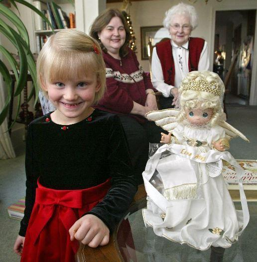 Natasha Cleveland, left, a 5-year-old former Russian orphan, has found a new exciting life with her adoptive mother Nancy Cleveland, back left, and grandmother Betty Sanders, back right. Natasha, who finds amazement in things many of us take for granted, is celebrating her first U.S. Christmas this year.
