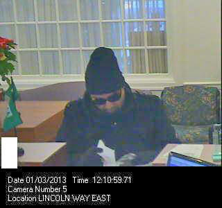 A man who robbed the M&T Bank on U.S. 30 in Guilford Township, Pa., Thursday afternoon is shown in this surveillance photo.