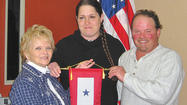 Judy Mason, a member of Antietam Unit 236, Sharpsburg American Legion Auxiliary, presented her son and daughter-in-law, Chris and Sabrina Fraley of Inwood, W.Va., with a Blue Star Service Banner at the Dec. 11 monthly meeting.