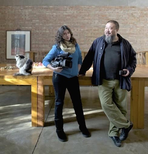 "Alison Klayman poses with multimedia artist Ai Weiwei. She created a documentary ""Weiwei: Never Sorry,"" which is showing Friday at the Forum Theater."
