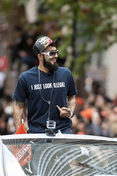 San Francisco Giants relief pitcher Sergio Romo reacts to the crowd during the World Series victory parade at Market Street.
