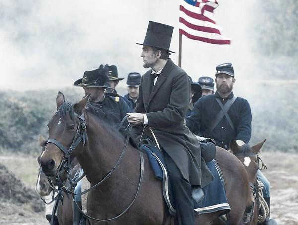 "President Abraham Lincoln (Daniel Day-Lewis) looks across a battlefield in the aftermath of a terrible siege in this scene from director Steven Spielberg's drama ""Lincoln."" If Features Editor Michael Miller had to make a list for 2012's best movies, ""Lincoln"" would probably be No. 1."
