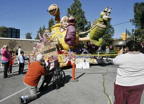 Crowds admire Burbank's Rose Parade float on Thursday, Jan. 3, 2013.