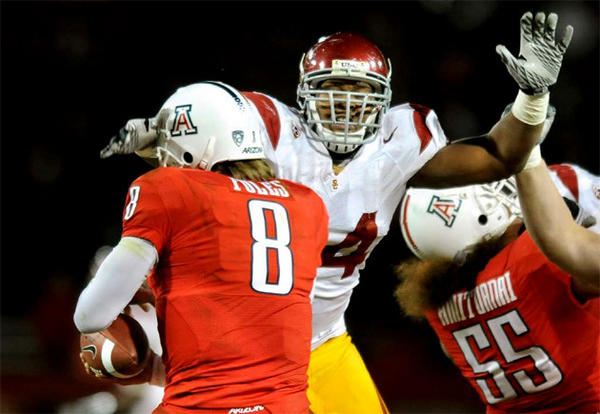 Armond Armstead gets a hand to the face of Arizona quarterback Nick Foles in 2010.