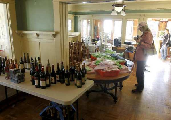 A woman browses T-shirts and the wine collection at the Cottage Restaurant.