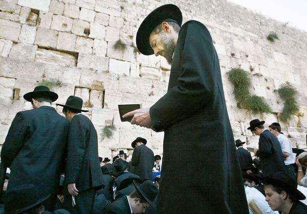 Jews pray during rituals at the Western Wall.