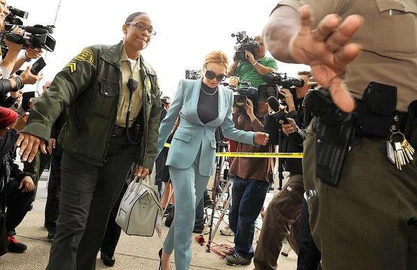 Lindsay Lohan, shown arriving for a court appearance in March, and other celebrities are fair game for the paparazzi, but there should be boundaries.
