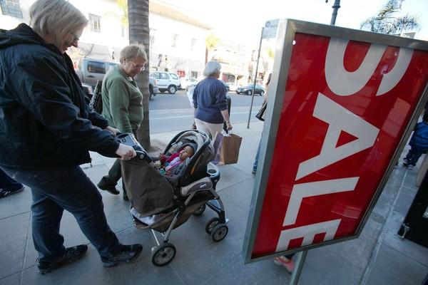 Shoppers strolling along Colorado Boulevard in Old Town Pasadena said they controlled their spending during the holidays and planned to take a break from buying in the new year.