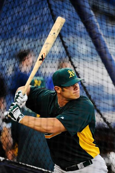 Anthony Recker takes batting practice with the Oakland Athletics before a game against the New York Yankees on August 23, 2011 in Yankee Stadium.