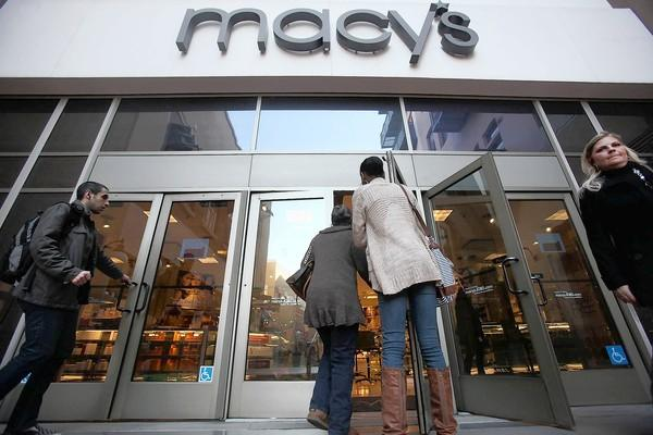 "Customers go in and out of the Macy's at the Paseo Colorado shopping mall in Pasadena. The retail giant announced that the store will close as part of plans to shut six ""underperforming"" stores nationwide."
