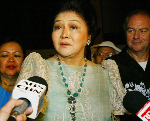 Former Philippine First Lady Imelda Marcos, shown in 2004, has emerged from foreign exile and scandal to resume a position of authority as legislator for the family stronghold of Ilocos Norte. With the widow, son and daughter of late dictator Ferdinand Marcos now politically resurrected, the government seems inclined to scrap the search for billions in state property Marcos was believed to have hidden before fleeing in 1986.