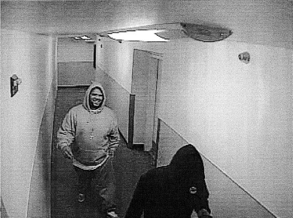 Anchorage police are looking for two men, seen on a Dec. 14 surveillance video, who sexually assaulted a woman and took her children's Christmas gifts. Anyone with information on the case is asked to call APD at 786-8900.