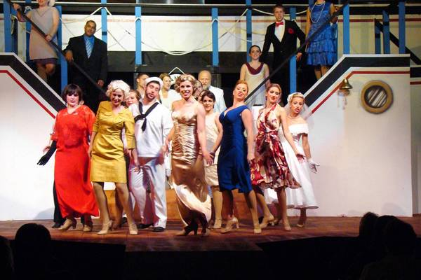 "In the Annapolis Summer Garden Theater production of ""Anything Goes,"" Nicole Anderson, center, performs as Reno Sweeney, supported by the show's cast. The local troupe marked its 47th season in 2012."