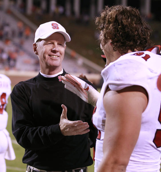 N.C. State's Tom O'Brien congratulates N.C. State's Markus Kuhn (91) as time runs out during the second half of play. N.C. State defeated Virginia, 28-14, at Scott Stadium in Charlottesville, Virginia, on Saturday, October 22, 2011. (Ethan Hyman/Raleigh News & Observer/MCT) ORG XMIT: 1113048