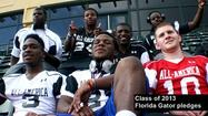 "<span style=""font-size: small;"">As they lined up during an impromptu photo shoot Wednesday at ESPN's Wide World of Sports, the eight University of Florida pledges participating in this year's Under Armour All-American Game were obviously having fun.</span>"
