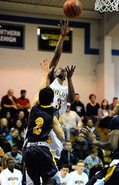 Wilson's Gerald Terry (back) shoots over Notre Dame's Jordan Jachim during a Colonial League game Thursday night.